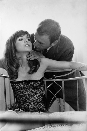 Marie-France Pisier and Jean-Louis Trintignant on the set of film Trans-Europ-Express by Alain Robbe-Grillet, 1966 Scan made from a press release print