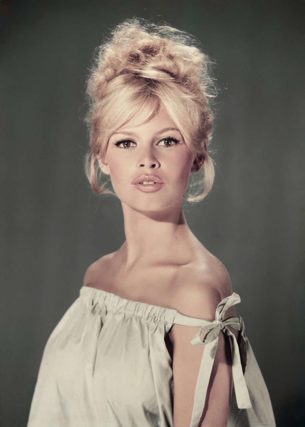 circa 1960: Studio portrait of actor and model Brigitte Bardot wearing a light blue off-the-shoulder dress. (Photo by Hulton Archive/Getty Images)